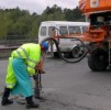ремонт дороги возле офисного центра Булак